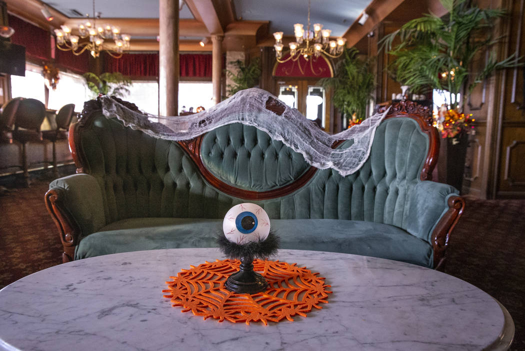 A large eyeball and Halloween decorations about the sitting room at the Mizpah Hotel in Tonopah ...
