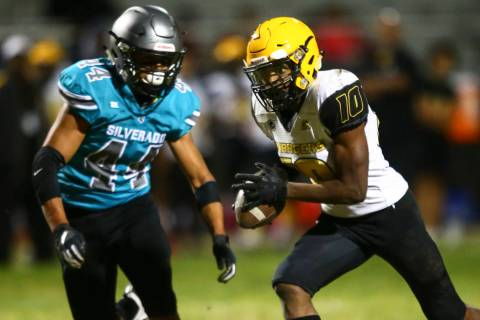 Clark's Dillan Lavender (10) runs the ball against Silverado's Chris Federico (44) during the f ...