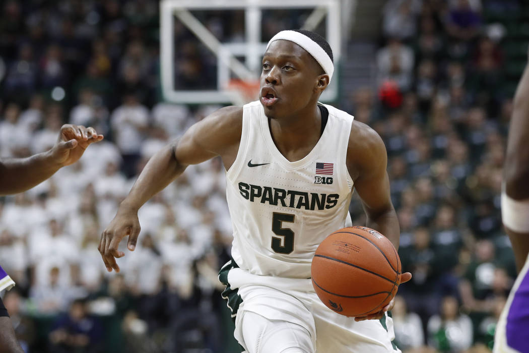 Michigan State guard Cassius Winston brings the ball up court during the second half of an NCAA ...