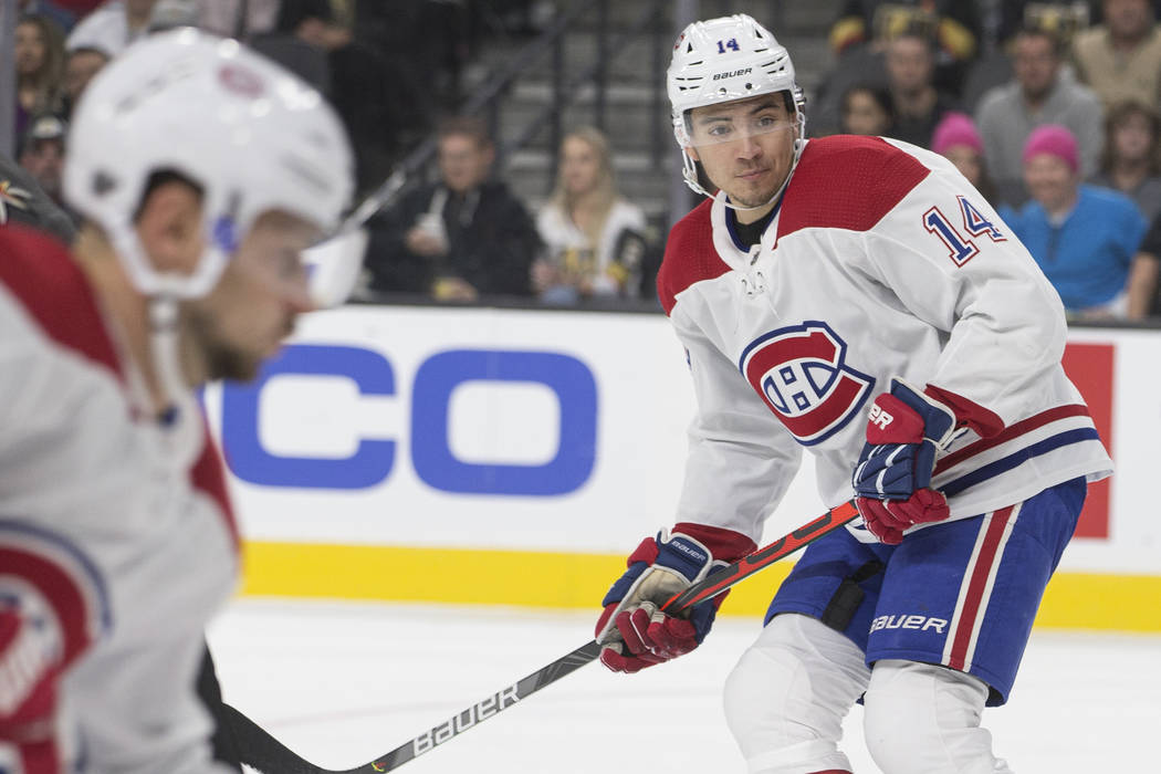 Montreal Canadiens center Nick Suzuki (14) skates up ice in the first period during an NHL hock ...