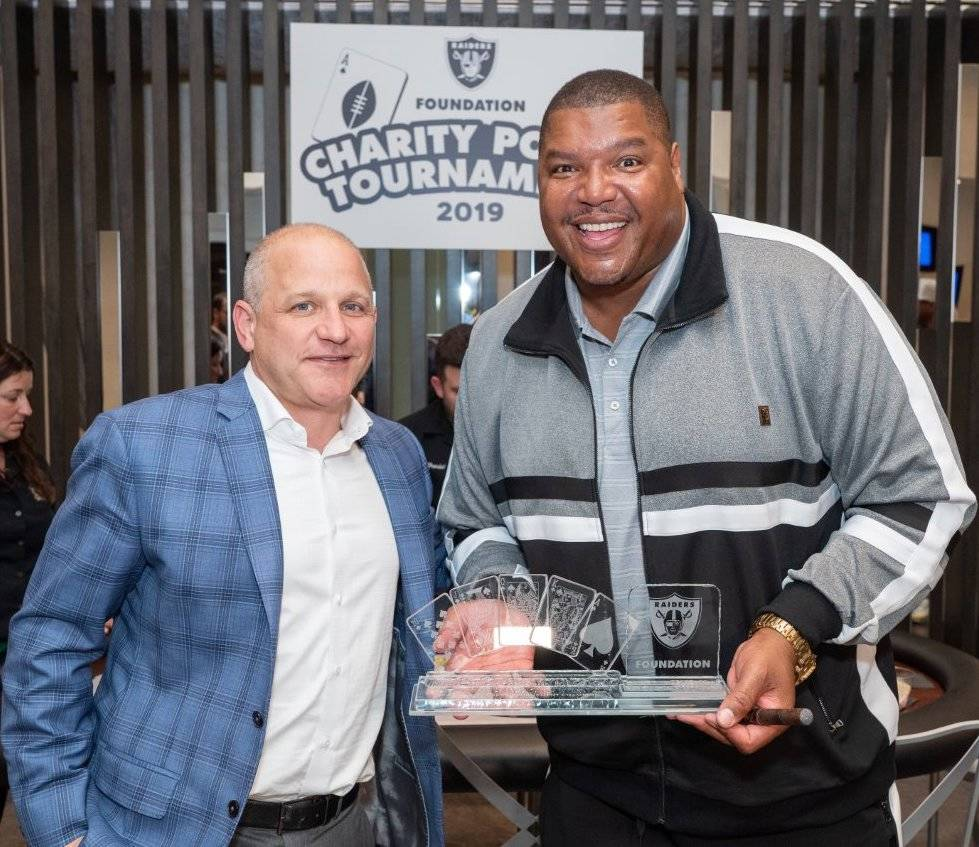Raiders President Marc Badain and ex-Raider great Lincoln Kennedy are shown on the scene at the ...