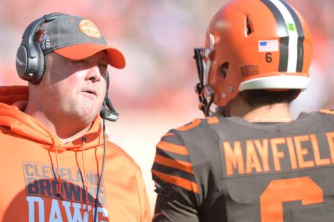 Cleveland Browns head coach Freddie Kitchens talks with quarterback Baker Mayfield (6) during a ...