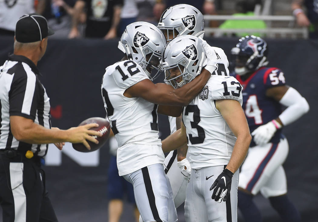 Oakland Raiders wide receiver Hunter Renfrow (13) celebrates his 65-yard touchdown catch agains ...