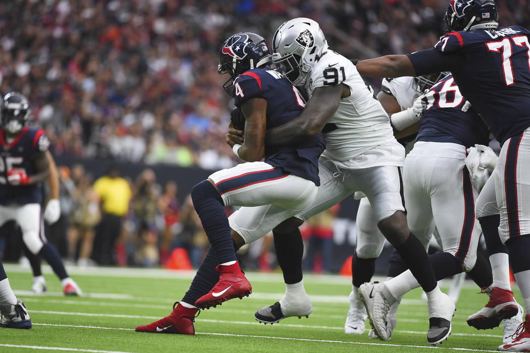 Houston Texans quarterback Deshaun Watson (4) is hit by Oakland Raiders defensive end Benson Ma ...