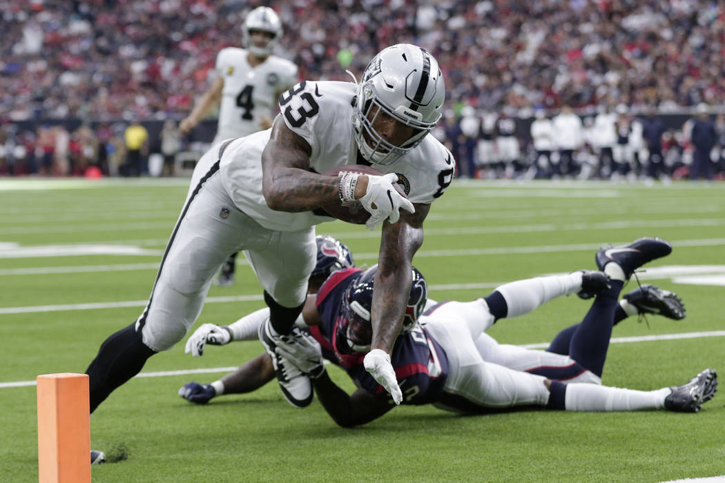 Oakland Raiders tight end Darren Waller (83) scores a touchdown against the Houston Texans afte ...