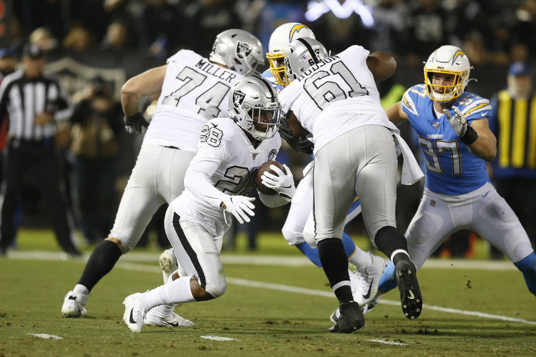 Oakland Raiders running back Josh Jacobs (28) runs against the Los Angeles Chargers during an N ...
