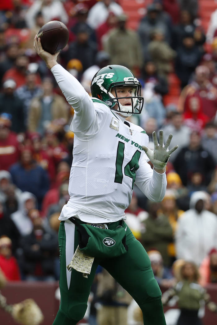 New York Jets quarterback Sam Darnold (14) pass the ball during the first half of an NFL footba ...
