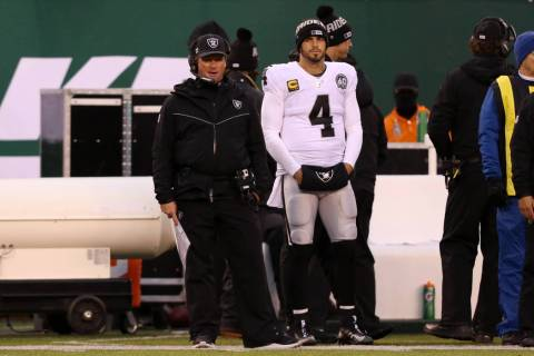 Oakland Raiders head coach Jon Gruden and quarterback Derek Carr (4) stand on the sideline afte ...