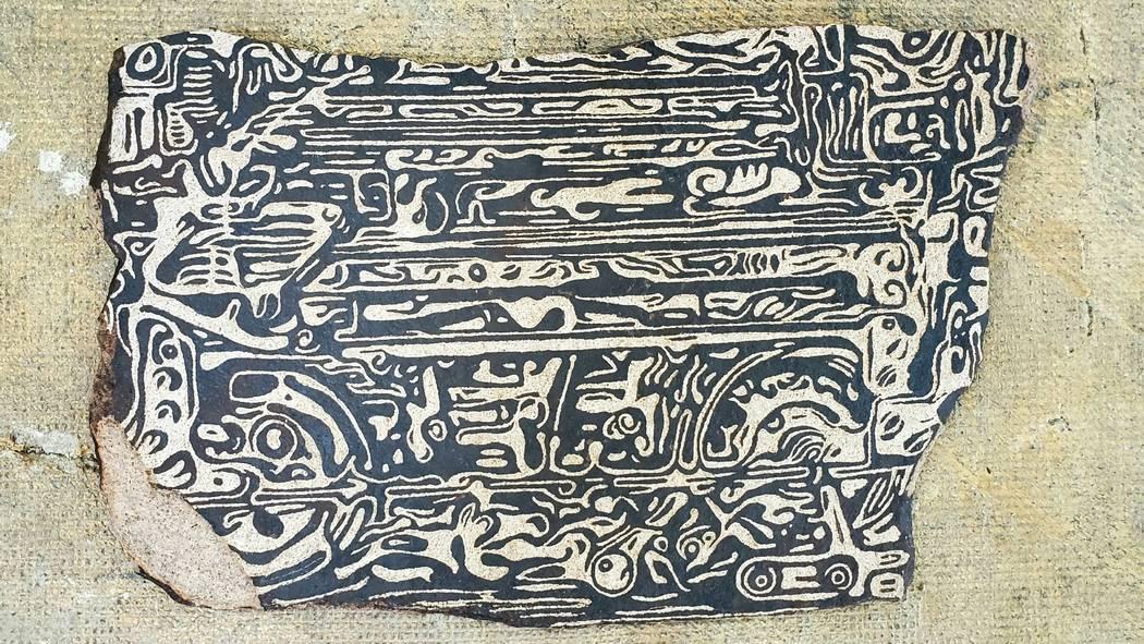 "A contemporary petroglyph by Thomas Larson, entitled ""Machinery."" (Core Contemporary)"