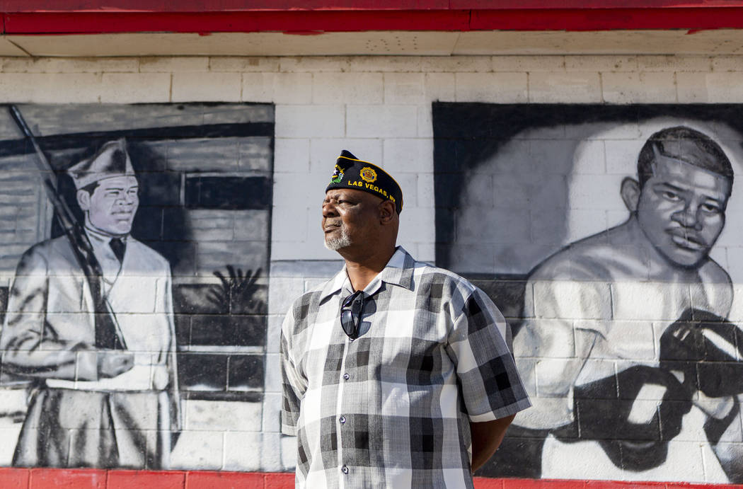 Navy veteran Kevin Felder stands amongst murals painted at American Legion Post 10 in Las Vegas ...