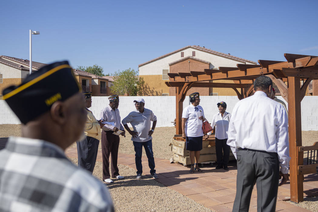American Legion Post 10 members converse in the newly renovated patio funded by a grant provid ...