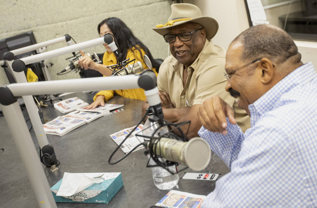 Su Phelps, Sammy R. Armstrong and Lionel Charles laugh during 88.1 FM's radio show at the KCEP ...