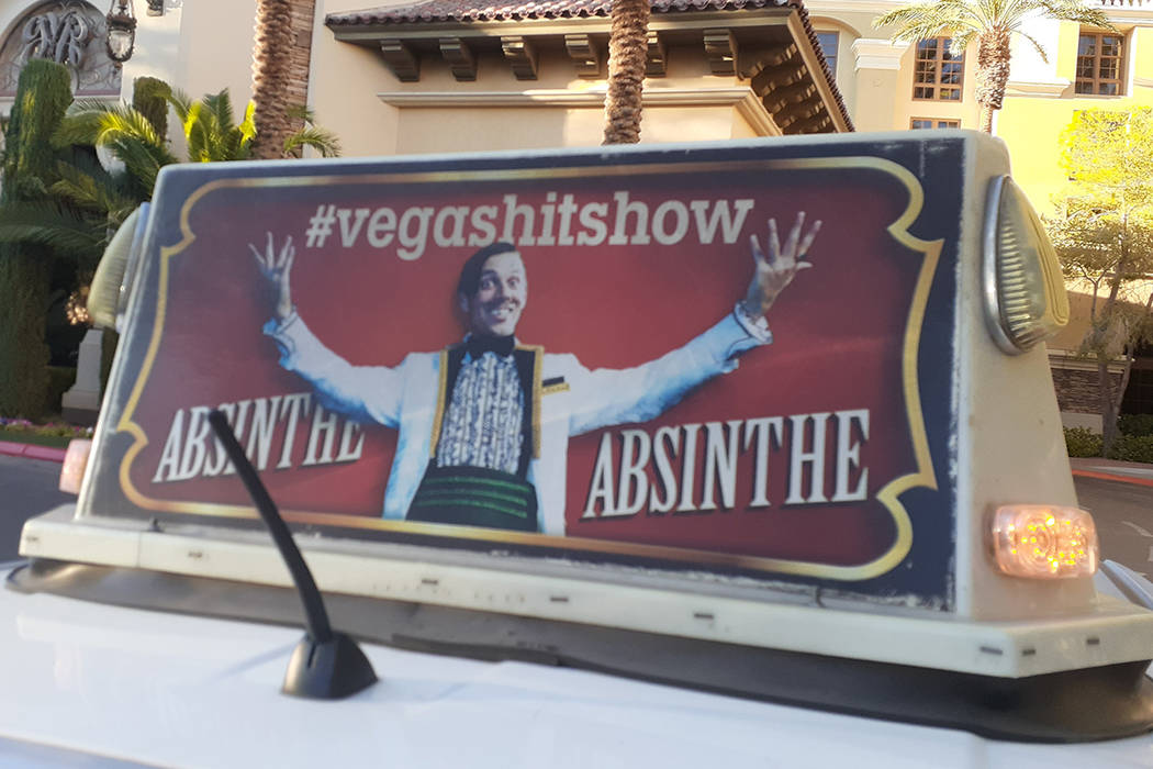 """An advertisement for the show """"Absinthe"""" seen atop a taxi Friday, Oct. 24, 2019, at G ..."""