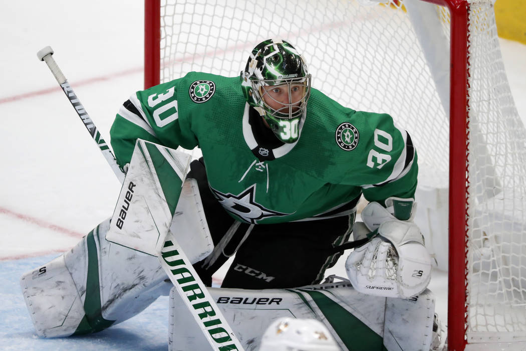 Dallas Stars goaltender Ben Bishop (30) minds the net during an NHL hockey game against the Pit ...