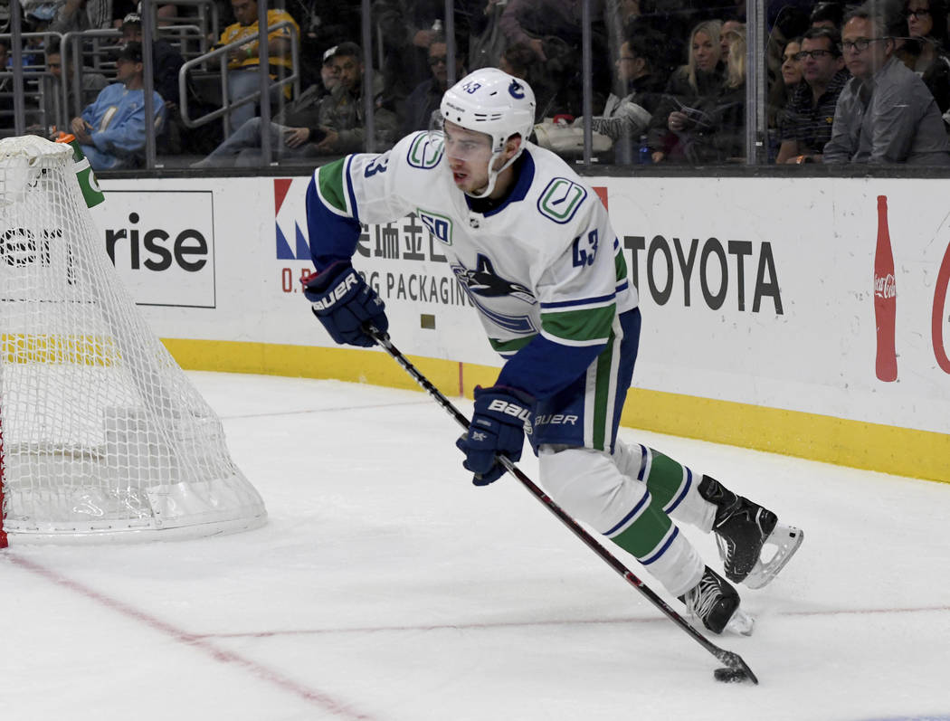 Vancouver Canucks defenseman Quinn Hughes in action against the Los Angeles Kings during an NHL ...