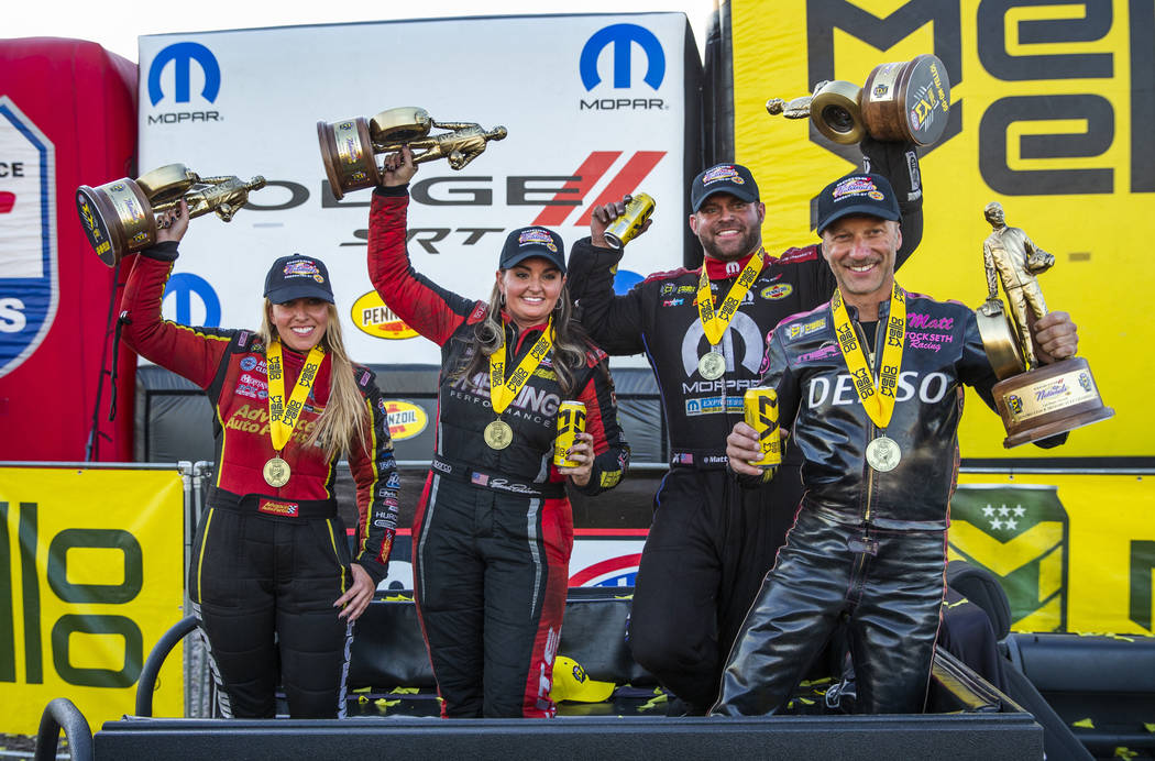 (From left) Race winners Brittany Force, Erica Enders, Matt Hagan and Matt Smith celebrate hold ...