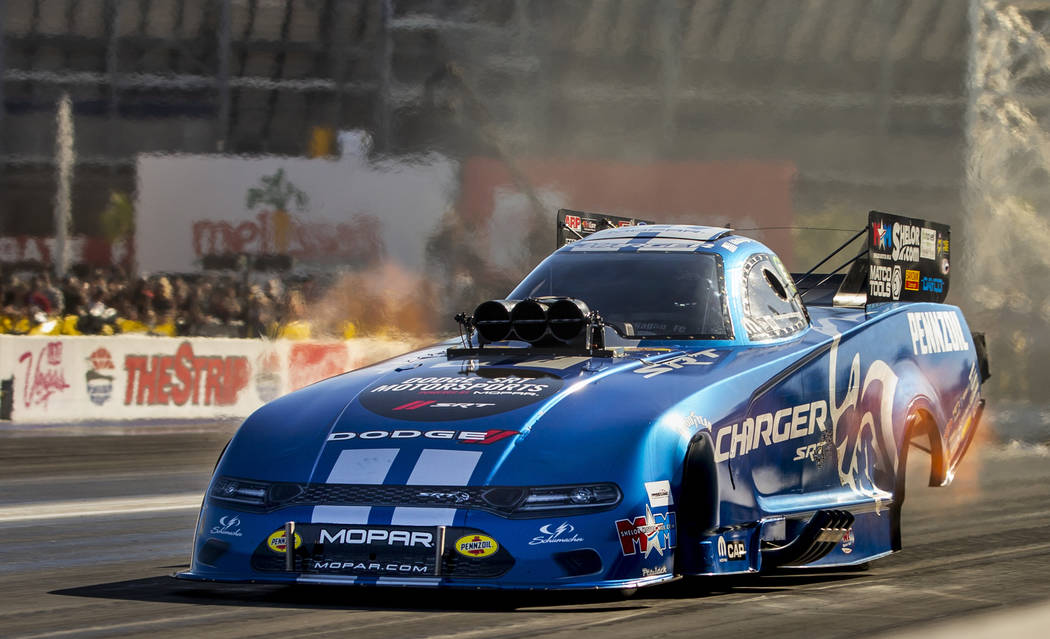 Funny car racer Matt Hagan takes the lead in the second round during the Dodge NHRA Nationals a ...