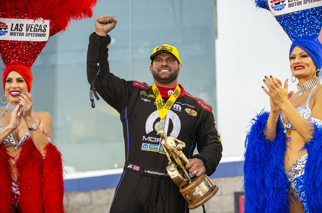 Funny Car racer Matt Hagan celebrates his win in the final round of the Dodge NHRA Nationals at ...