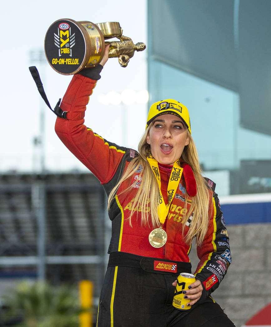 Top Fuel racer Brittany Force celebrates her win in the final round of the Dodge NHRA Nationals ...