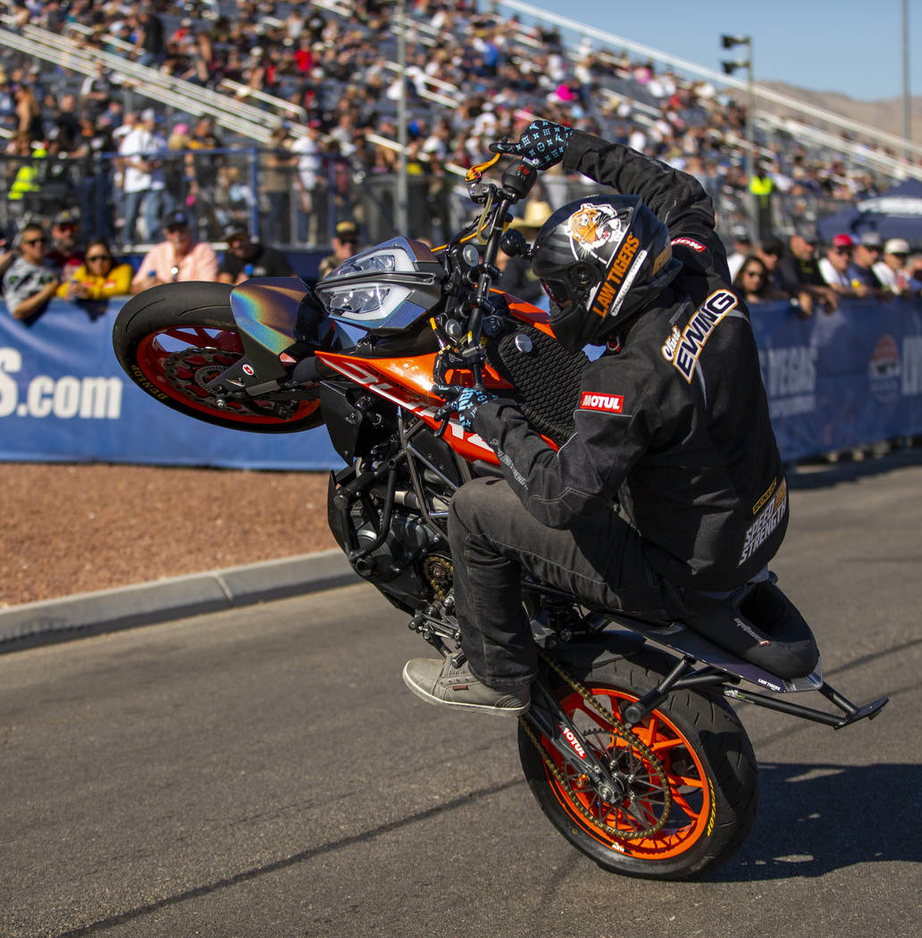 Stunt rider Clint Ewing entertain the fans before the start of the second round of the Dodge NH ...