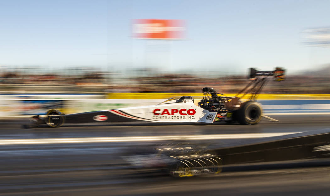Top Fuel racer Steve Torrence surges ahead during the second round of the Dodge NHRA Nationals ...