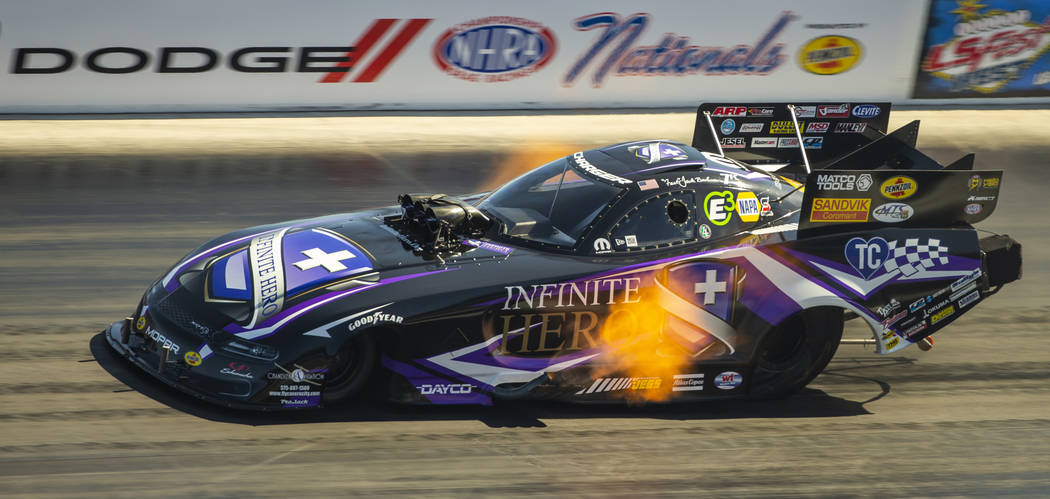 Funny Car racer Jack Beckman gets on the gas during the first round of the Dodge NHRA Nationals ...