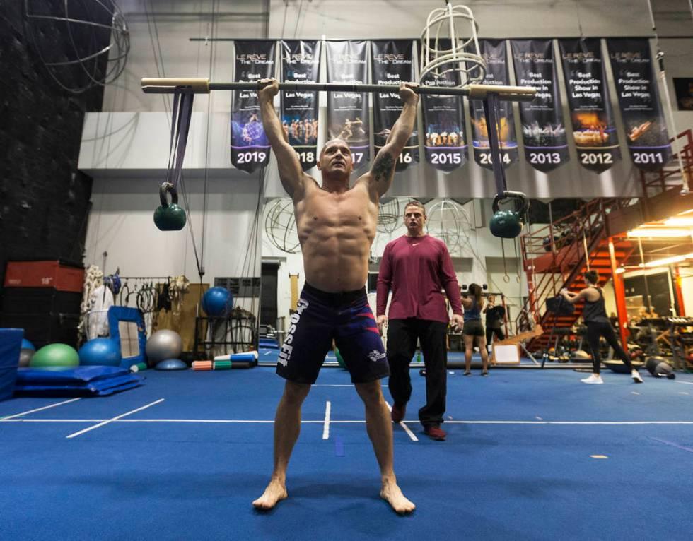 Gymnast Mirek Niepielski, left, does overhead squats under the supervision of Steve McCauley, h ...