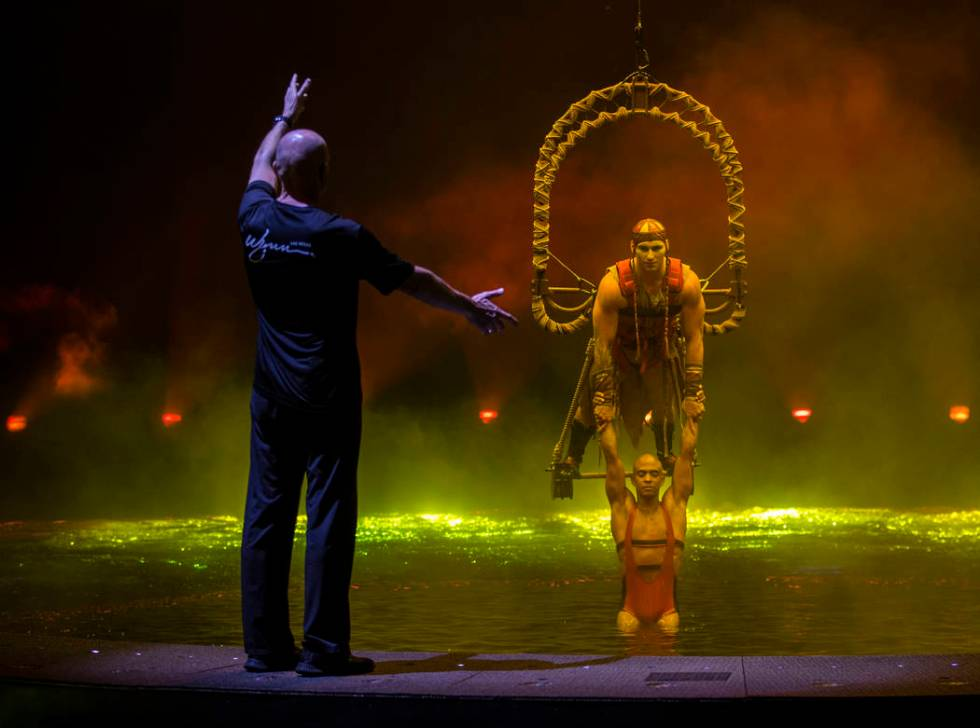 Aerial conceptor, coach and performer Didier Antoine, left, gives direction to Ryan Bartlett, t ...