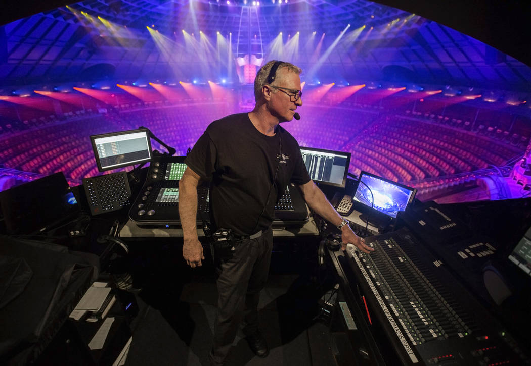 Assistant head of lighting Tracer Finn makes adjustments to show lights during rehearsal for &q ...