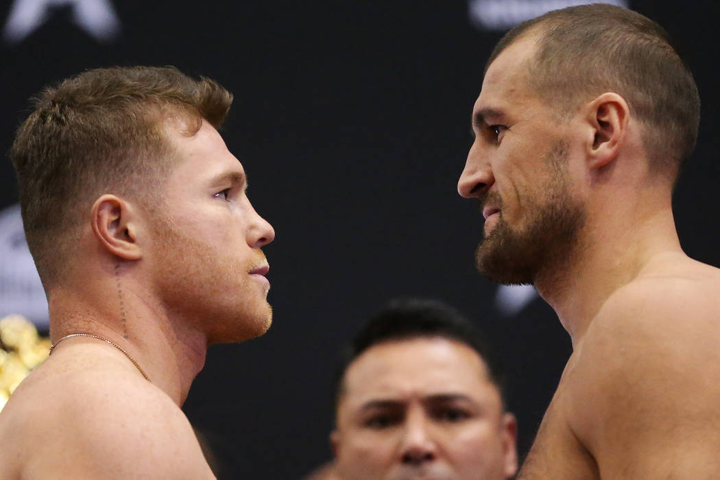 """Saul """"Canelo"""" Alvarez, left, and Sergey Kovalev pose during a weigh-in event at the M ..."""