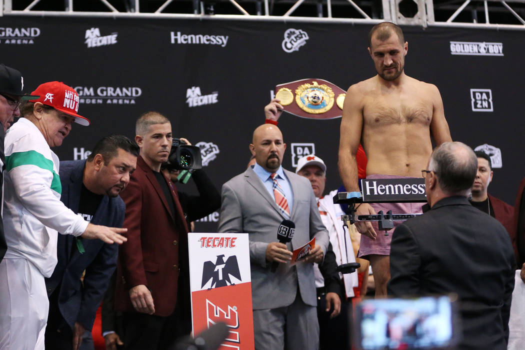 People watch as Sergey Kovalev steps on the scale during a weigh-in event at the MGM Grand Gard ...