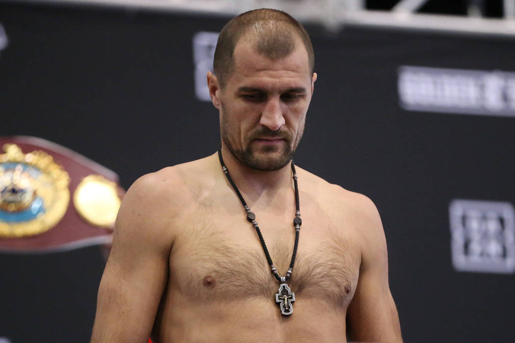Sergey Kovalev stands on the scale during a weigh-in event at the MGM Grand Garden Arena in Las ...