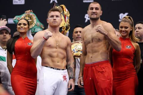 "Saul ""Canelo"" Alvarez, left, and Sergey Kovalev pose during a weigh-in event at the M ..."