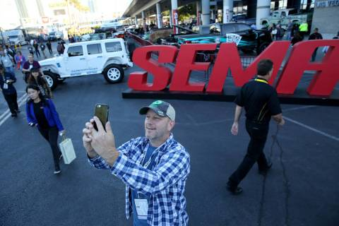 David Fortuna of North Branch, Minn. takes a selfie at the Specialty Equipment Market Show at t ...