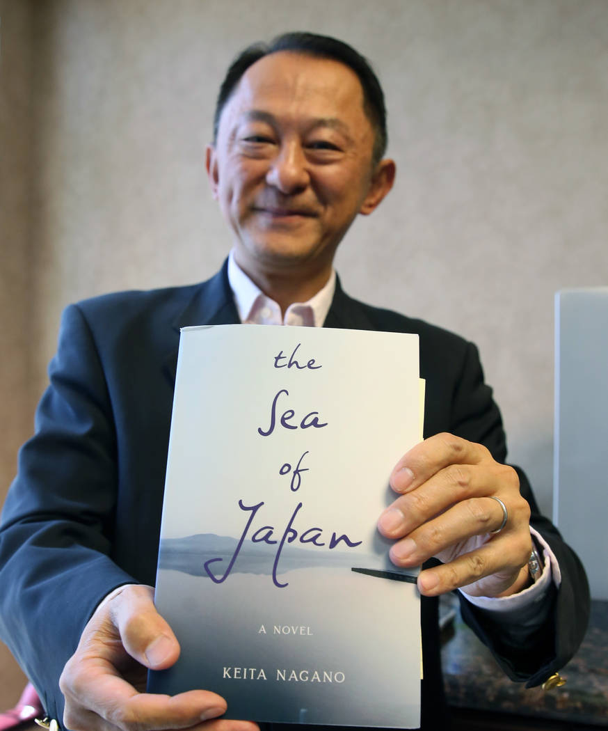 """Keita Nagano, an author of """"The Sea of Japan,"""" poses for photo at his Henderson offic ..."""