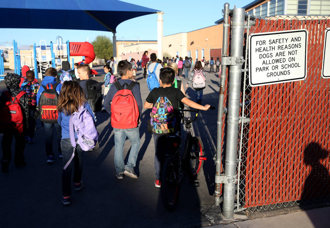 Students arrive at the start of the school day at Manch Elementary in Las Vegas Tuesday, Oct. 2 ...