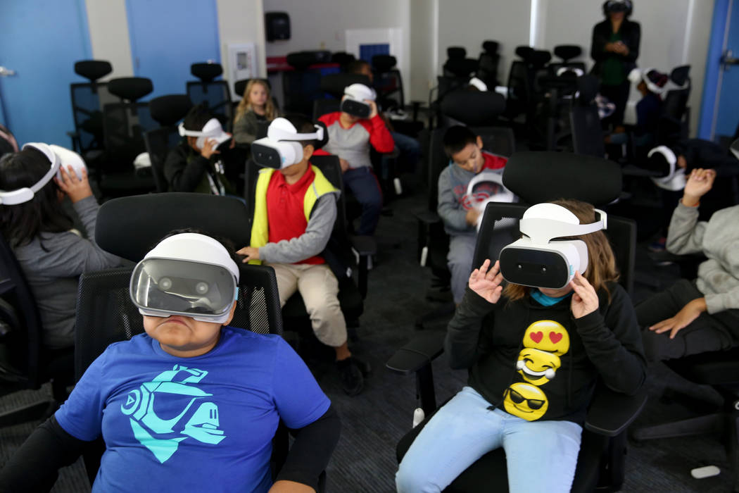 Students in Franchester Dailey's fourth grade class swim with sharks in the virtual realty lab ...