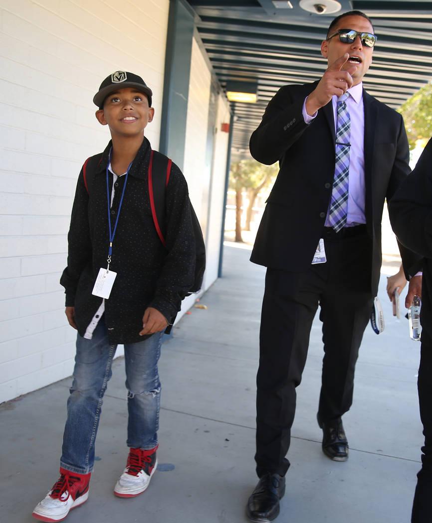 Principal Anthony Nunez walks sixth grader Albert Breedlove back to class to get a pass at Orr ...