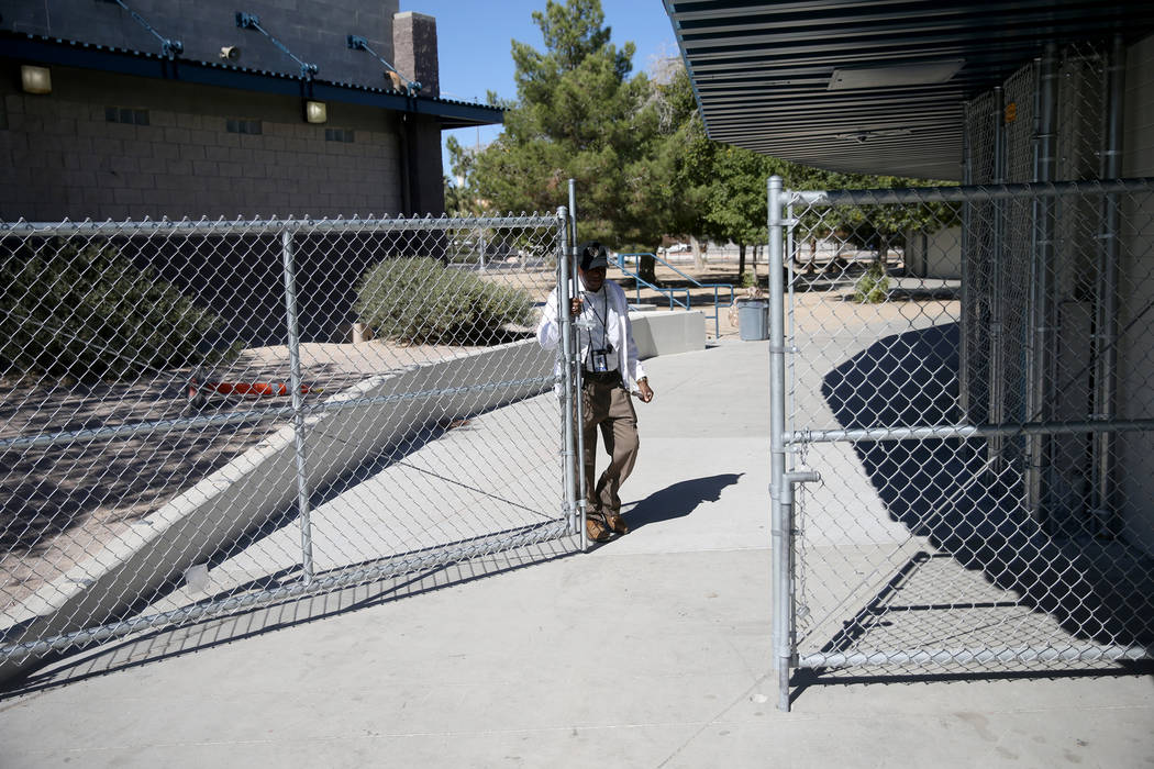 Monitor Henry Grant closes the fence after lunch at Orr Middle School in Las Vegas Monday, Oct. ...