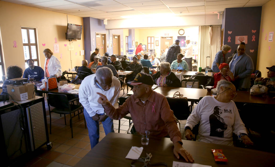 Seniors partake in a variety of activities in the multipurpose room, including movie-watching, ...