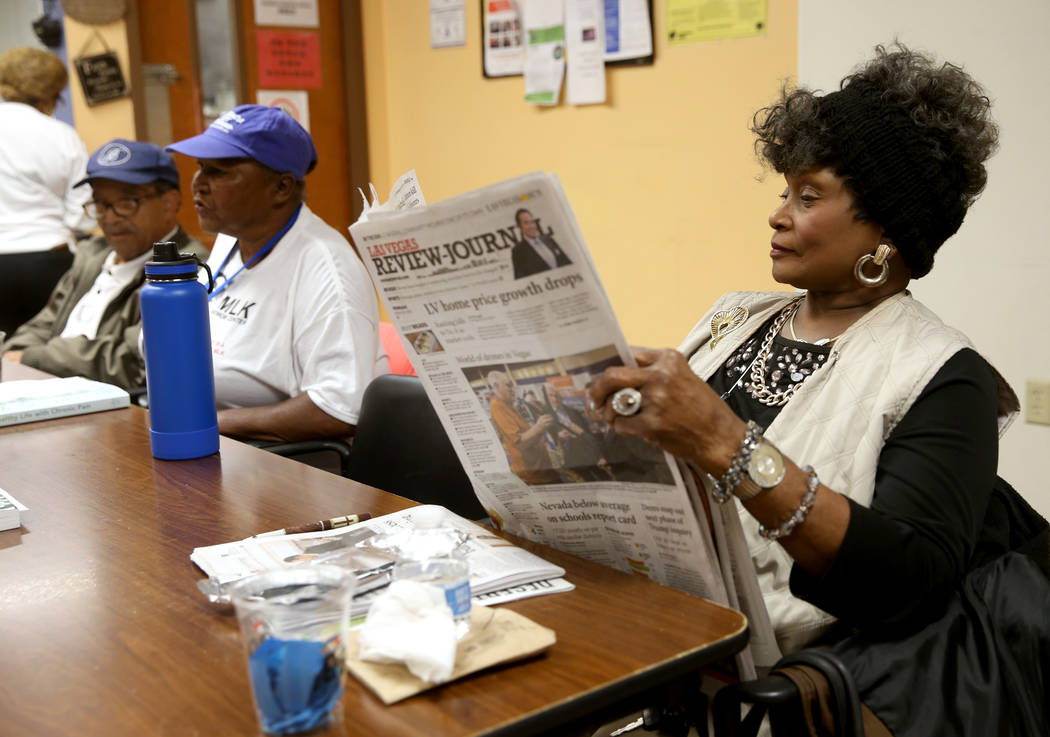 Ada Glover, 76, reads the paper at Martin Luther King Jr. Senior Center in North Las Vegas Wedn ...