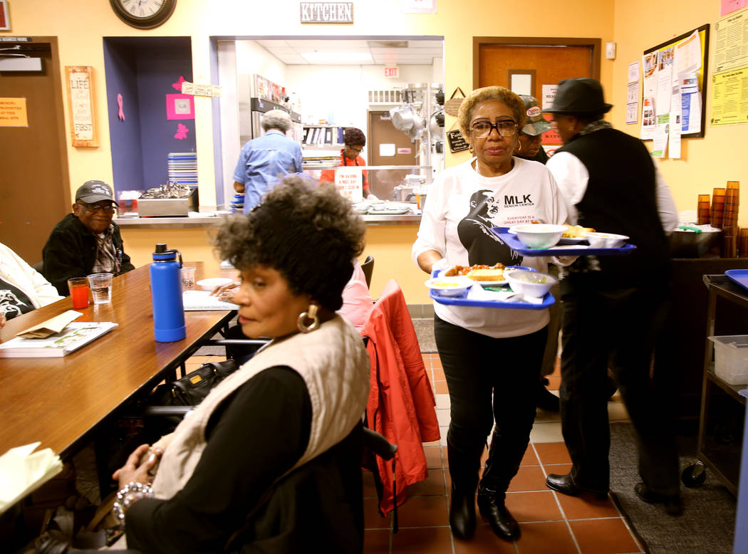 Mary Davis serves lunch at Martin Luther King Jr. Senior Center in North Las Vegas Wednesday, O ...