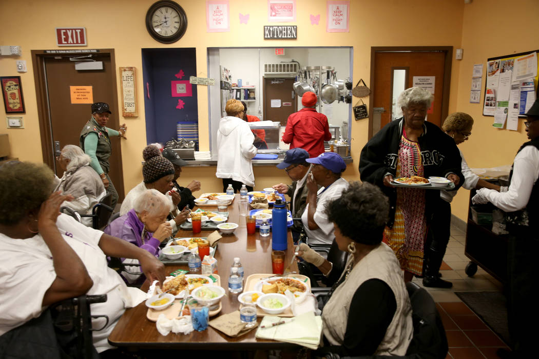 Senior crowd into the lunchroom at Martin Luther King Jr. Senior Center in North Las Vegas Wedn ...