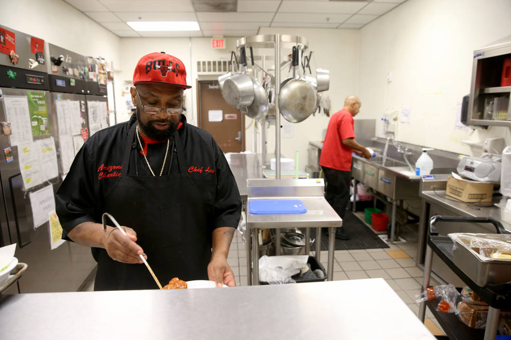 Les Johnson dishes up lunch at Martin Luther King Jr. Senior Center in North Las Vegas Wednesda ...