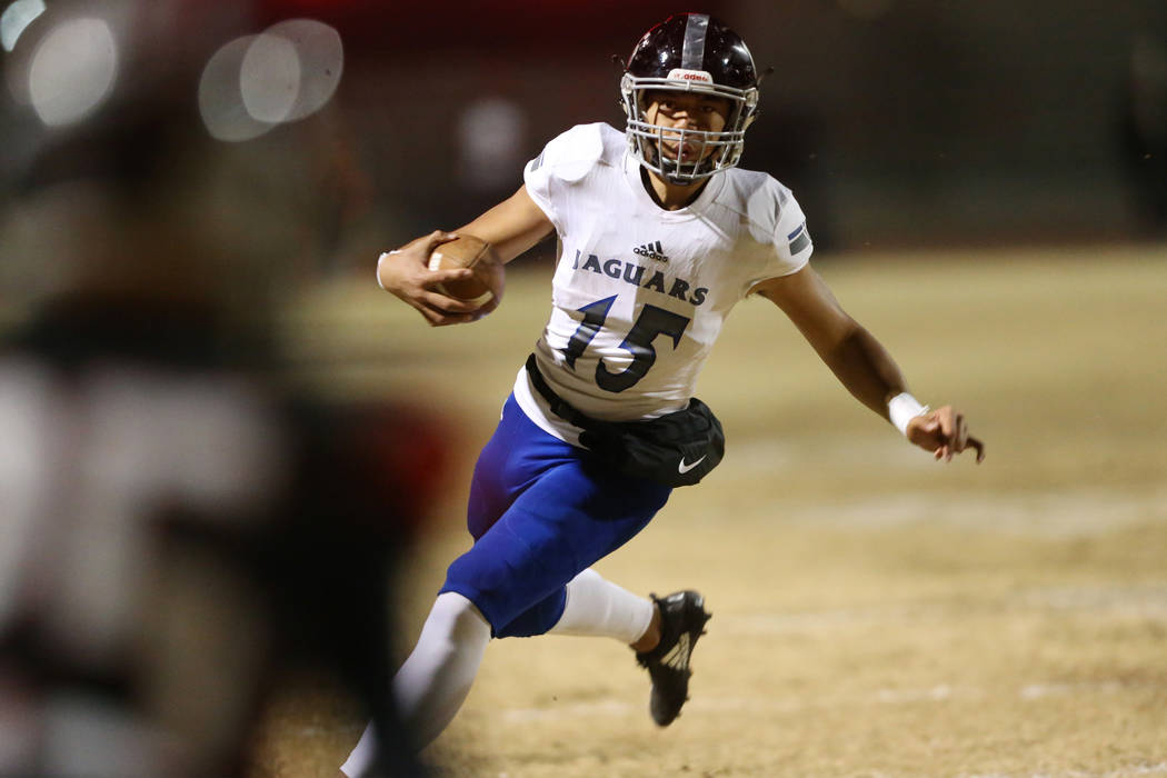 Desert Pines Rjay Tagataese (15) runs the ball against Las Vegas during the second quarter of a ...