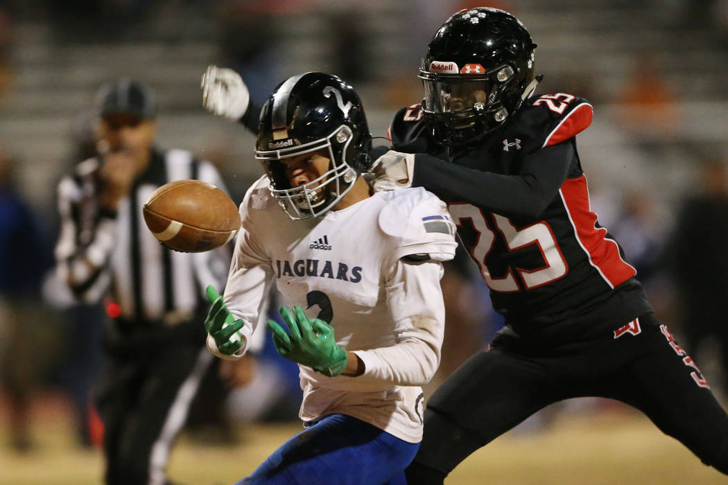 Desert Pines Deandre Moore (2) is tackled by Las Vegas Bryon Inmon (25) while attempting to cat ...