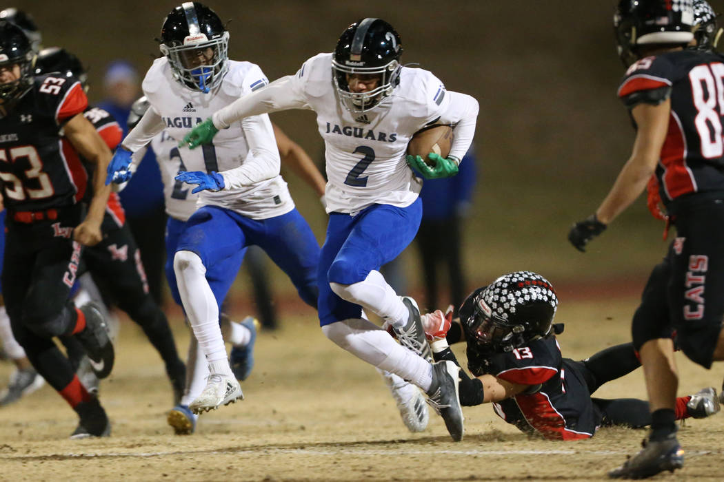 Desert Pines Deandre Moore (2) is tackled by Las Vegas Dalton Silet (13) while retuning a kicko ...