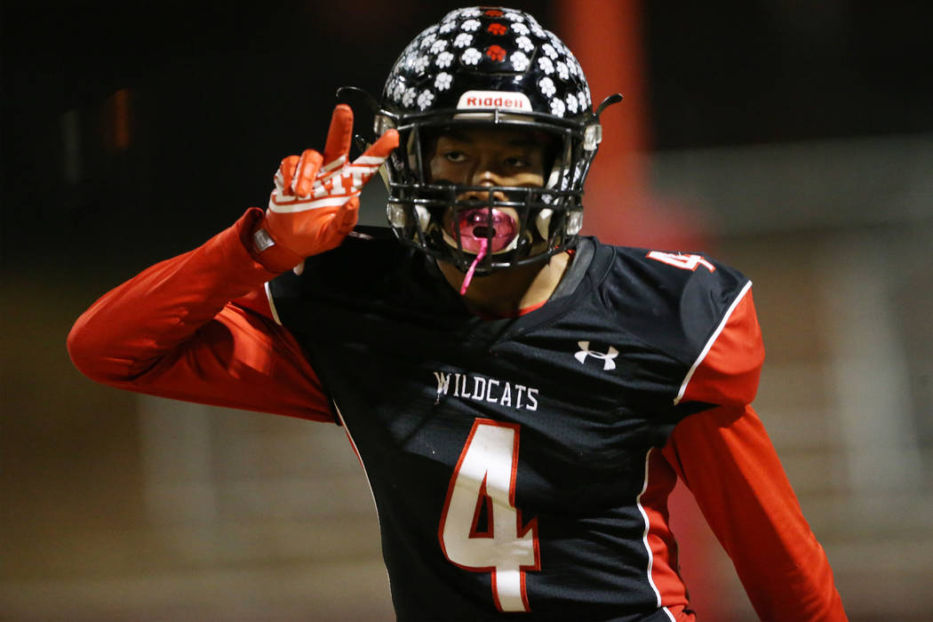 Las Vegas Victory David (4) celebrates a touchdown against Desert Pines in a football game at L ...