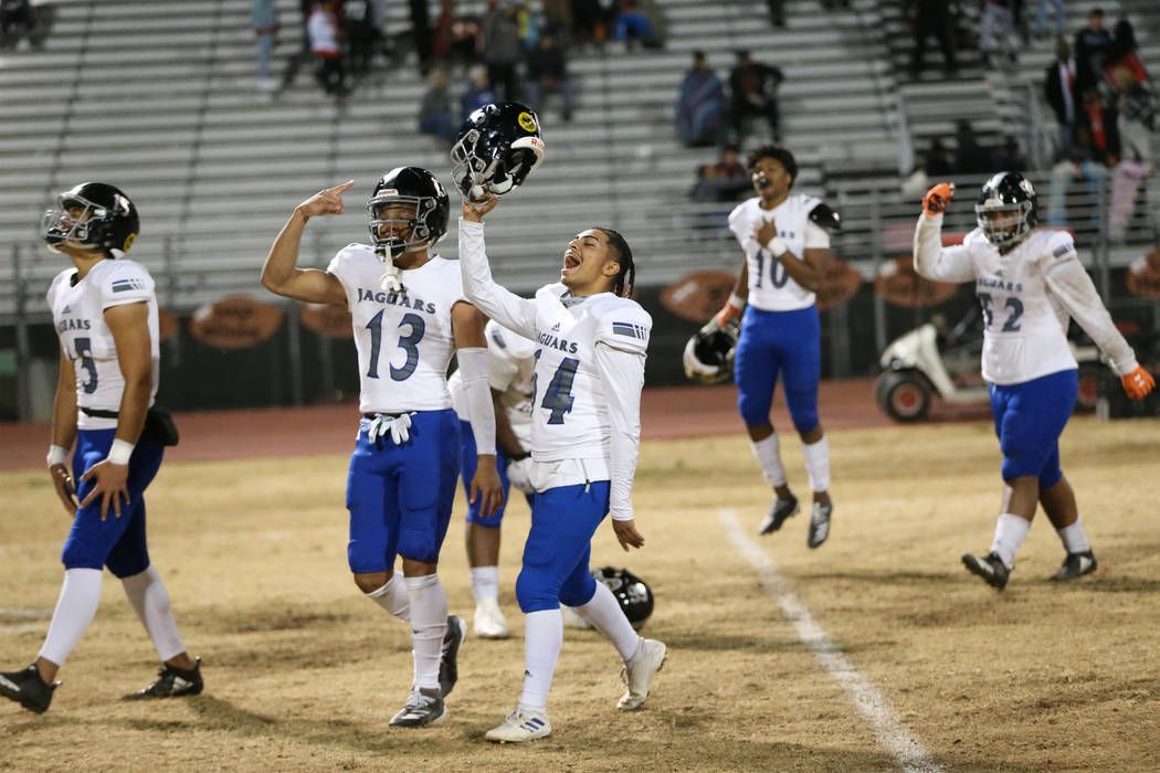 Desert Pines players from left, Rjay Tagataese (15), Michael Jackson (13), Luis Magana (64), Ma ...