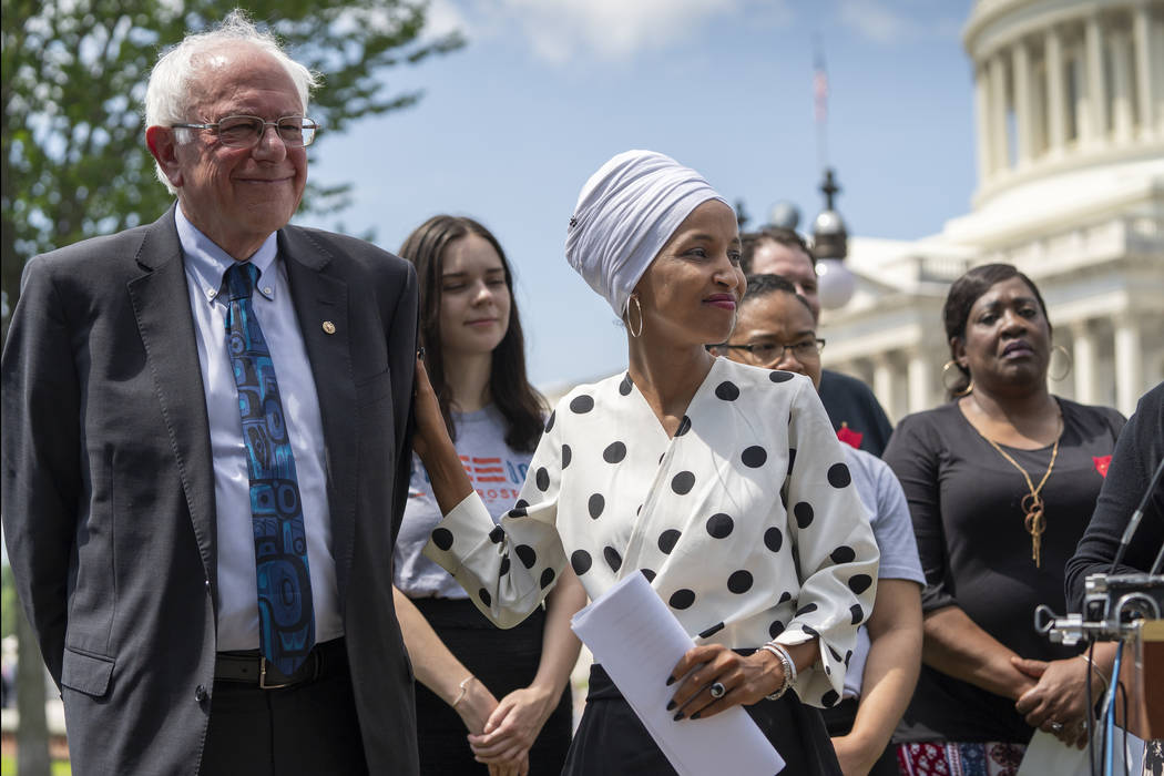 Democratic presidential candidate, Sen. Bernie Sanders, I-Vt., left, and Rep. Ilhan Omar, D-Min ...